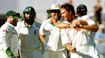 Paul Harris celebrates the wicket of Phil Hughes with his team-mates
