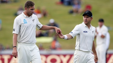 Tim Southee is handed the ball by Neil Wagner
