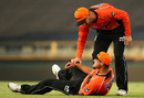 Nathan Coulter-Nile winces in pain after hurting his shoulder, Perth Scorchers v Adelaide Strikers, Big Bash League 2015-16, Perth, December 21, 2015