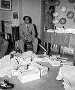 Datta Gaekwad shops for shoes in London, April 20, 1959