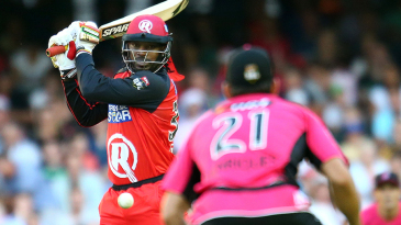 Chris Gayle muscles a ball through the off side