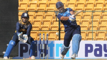 MS Dhoni drills one down the ground during his unbeaten 70