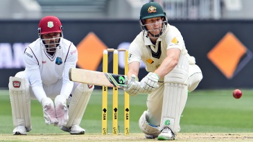 Adam Voges lines up to paddle the ball