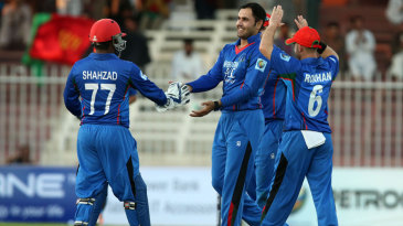 Mohammad Nabi celebrates a wicket with teammates