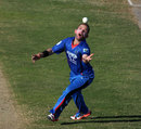 Debutant Rokhan Barakzai holds on to a catch, Afghanistan v Zimbabwe, 2nd ODI, Sharjah, December 29, 2015