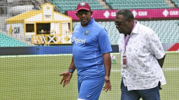 Phil Simmons chats with Clive Lloyd during a practice session