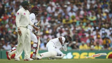 Kraigg Brathwaite slips over shortly before Marlon Samuels is run out