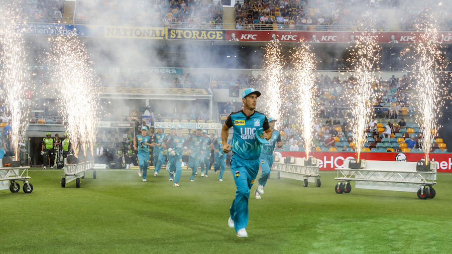 Chris Lynn leads his players out