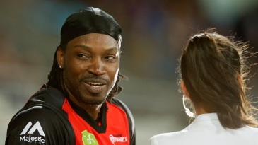 Chris Gayle gives a boundary line interview to Mel McLaughlin