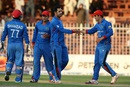 Mohammad Nabi celebrates a wicket with his team-mates, Afghanistan v Zimbabwe, 5th ODI, Sharjah, January 6, 2016