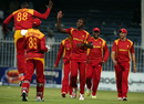Luke Jongwe celebrates his early strikes with his team-mates, Afghanistan v Zimbabwe, 5th ODI, Sharjah, January 6, 2016