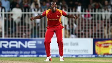 Luke Jongwe is elated after taking a wicket