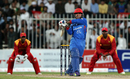 Hashmatullah Shahidi whacks the ball through the leg side, Afghanistan v Zimbabwe, 5th ODI, Sharjah, January 6, 2016