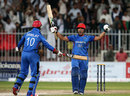 Gulbadin Naib and Dawlat Zadran celebrate Afghanistan's historic win, Afghanistan v Zimbabwe, 5th ODI, Sharjah, January 6, 2016