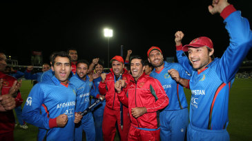 The Afghanistan players soak in the celebrations after securing the series