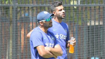Rishi Dhawan and Barinder Sran await their chance in the nets