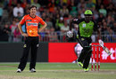 Brad Hogg looks on as Andre Russell goes through with a run, Sydney Thunder v Perth Scorchers, BBL 2015-16, Sydney, January 7 2016