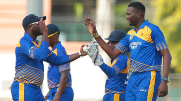 Sulieman Benn celebrates one of his four wickets