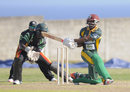 Devon Smith sweeps during his 91, Guyana v Windward Islands, Nagico Super50 2016, Basseterre, January 7, 2016