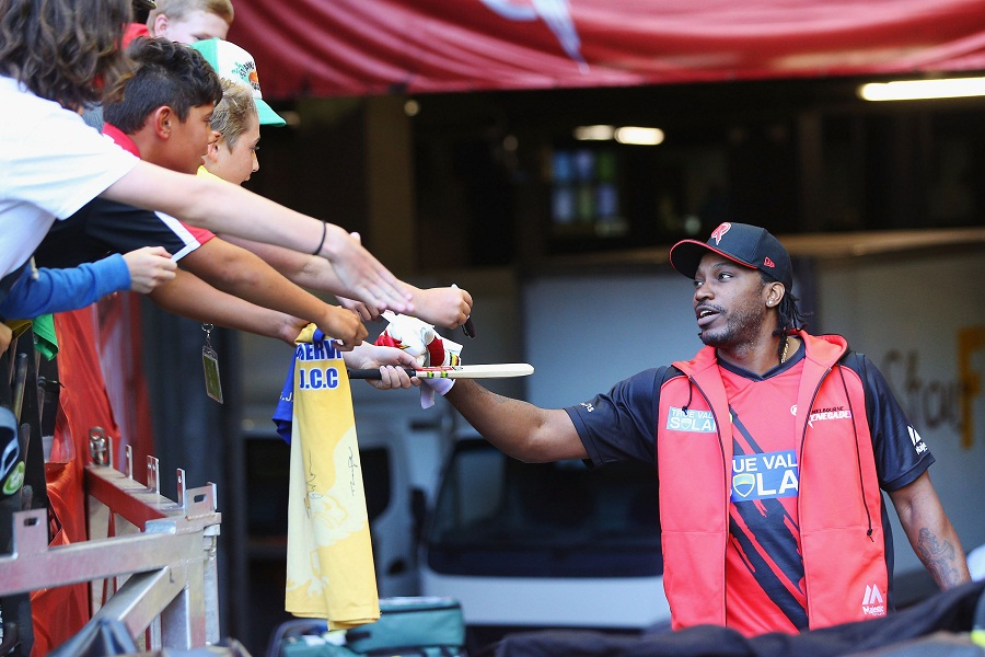 Chris Gayle is greeted by fans at the ground
