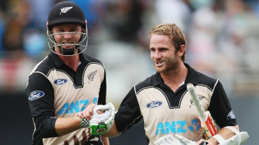Kane Williamson and Colin Munro walk off after sealing a nine-wicket win for New Zealand
