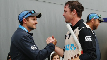 Colin Munro is greeted by New Zealand coach Mike Hesson after he smashed a 14-ball 50