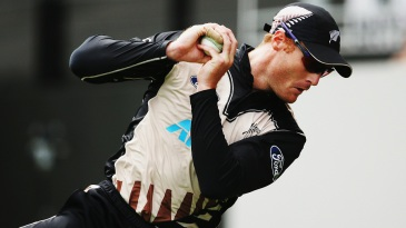 Martin Guptill completes a catch at the midwicket boundary