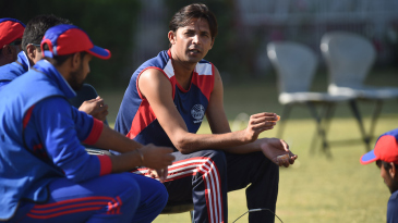 Mohammad Asif sits on the sidelines during a one-day match