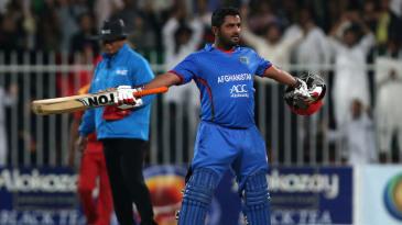 Mohammad Shahzad celebrates his century in his trademark style