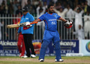 Mohammad Shahzad celebrates his century in his trademark style, Afghanistan v Zimbabwe, 2nd T20I, Sharjah, January 10, 2016