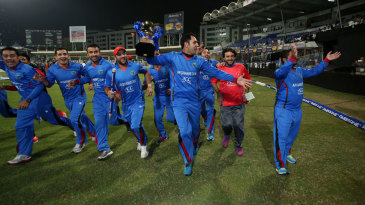 The victorious Afghanistan team celebrate with a lap around the ground