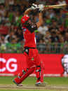 Cameron White hits out and plays a straight loft, Sydney Thunder v Melbourne Renegades, Big Bash League 2015-16, Sydney, January 11, 2016
