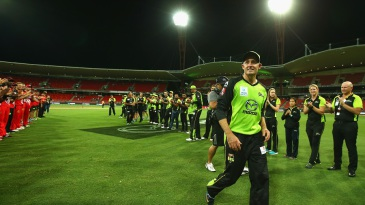 Michael Hussey leaves the field through a guard of honour