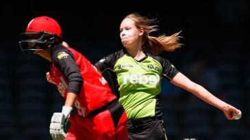 Lauren Cheatle runs in to bowl