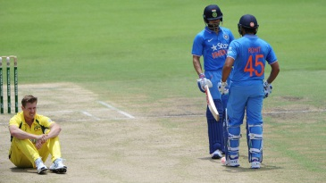 James Faulkner sits on the pitch during Virat Kohli and Rohit Sharma's stand