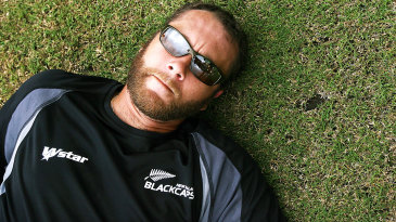 That's it for me boys: Craig McMillan lies down on the grass during practice