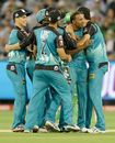 Samuel Badree is mobbed by team-mates after taking a wicket, Melbourne Stars v Brisbane Heat, Big Bash League 2015-16, Melbourne, MCG, January 14, 2016