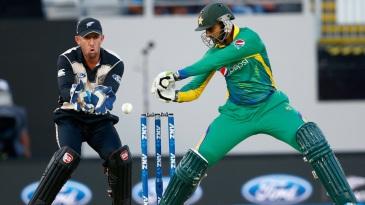 Shoaib Malik goes back to play a cut
