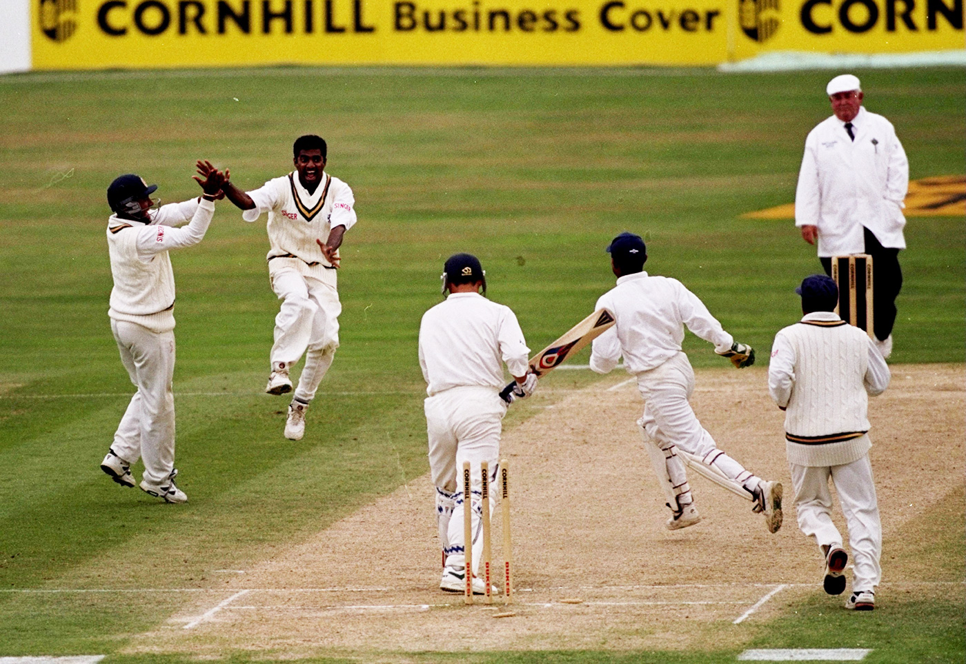 Muttiah Muralitharan takes the wicket of Darren Gough
