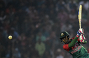 Mushfiqur Rahim lofts the ball through the off side, Bangladesh v Zimbabwe, 1st T20I, Khulna, January 15, 2016