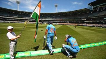 Rohit Sharma and Shikhar Dhawan walk out to bat at the MCG