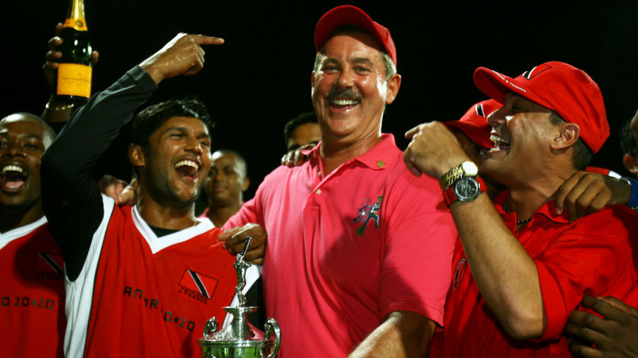 Tr&T captain Daren Ganga celebrates the victory with Allen Stanford