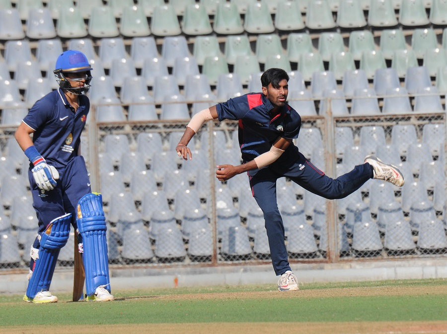 Akshay Karnewar bowls left-arm spin for Vidarbha in a T20 game