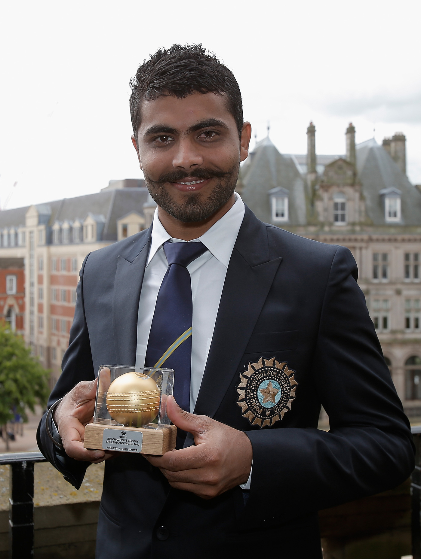 Golden arm: with the medal for the leading wicket-taker at the end of the 2013 Champions Trophy