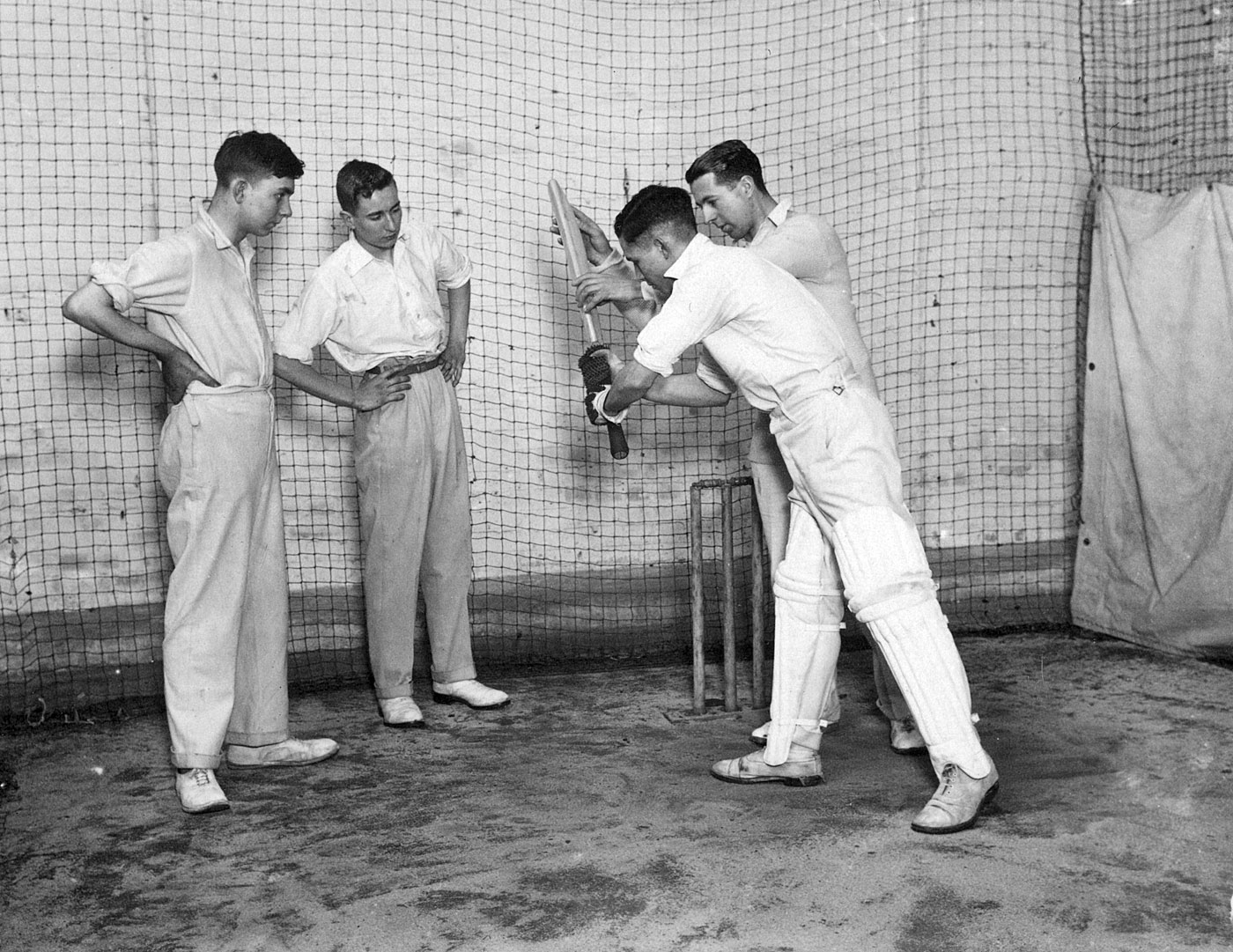 A batting tutorial at Faulkner's cricket school in Richmond, circa 1930, where several distinguished cricketers were to be found, despite the lack of amenities