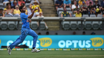 Bhuvneshwar Kumar runs in to bowl