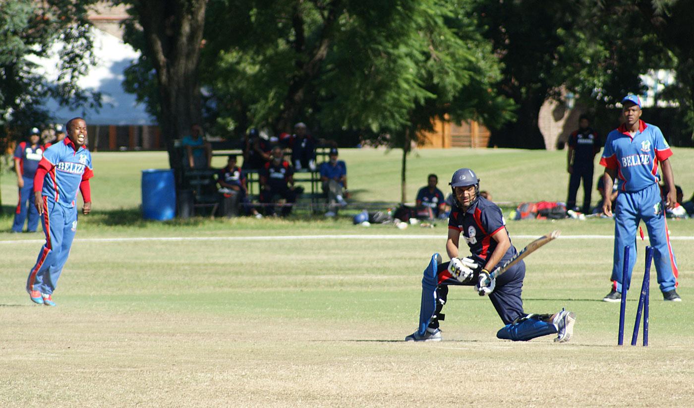 Belize's Mykelt Anthony bowls a Panama batsman