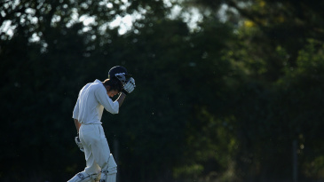 A player walks off the field during a village cricket match