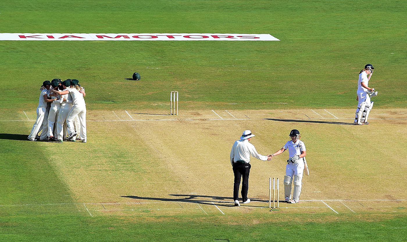 Australia celebrate the final wicket