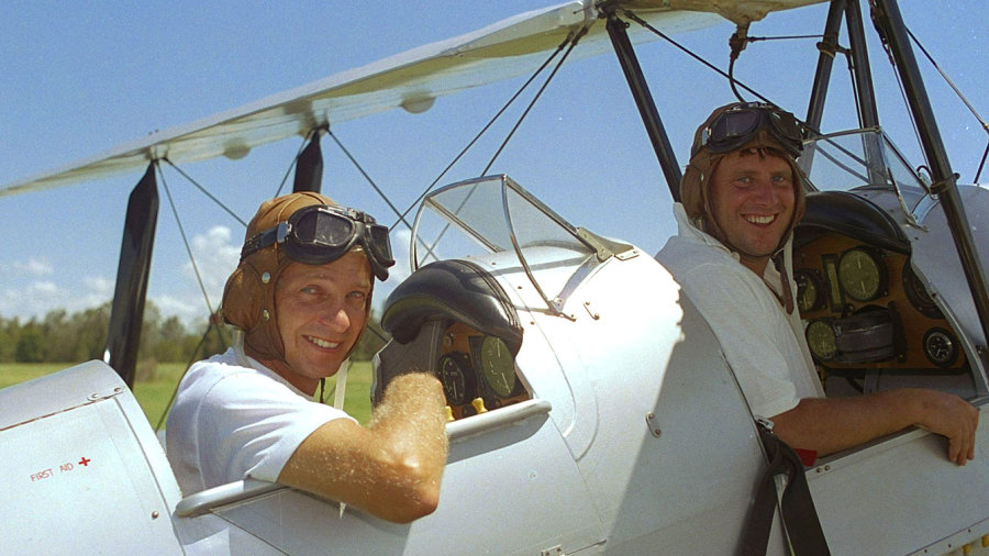 David Gower and John Morris pose in a Tiger Moth